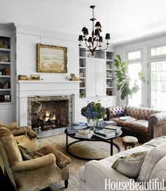 Fantastic Leather Sofa & Antique Cowhide French Armchairs - Rustic Home Decorating Ideas - House Beautiful