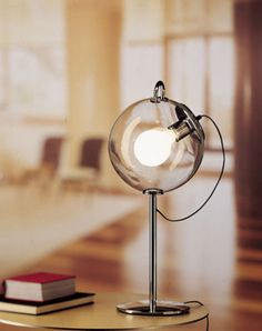 The Miconos suspension light was designed by the founder of Artemide, Ernesto Gismondi. A light with a raw, exposed design made of blown glass and chrome plated metal. Light In, Desk Light, Lamp Light, Orb Light, Diffused Light, Cool Lighting, Modern Lighting, Lighting Design, Custom Lighting