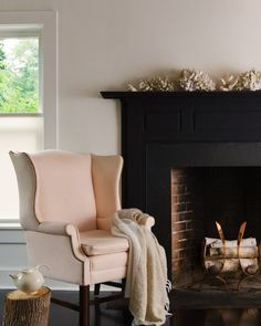 black fireplace surround and pale pink wing chair. Black And Cream Living Room, Cream Living Rooms, Black Fireplace Surround, Fireplace Surrounds, Home Fireplace, Fireplace Design, Paint Fireplace, Fireplace Frame, Brick Fireplaces