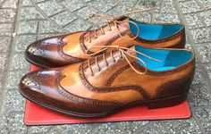 Dominique Saint Paul's Crust Calf wingtip patina oxfords in shades of teak and oak. Match 'em with any old denim jeans. Or your best Saville Row suit.