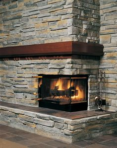 Corner design fireplace - very cool. Or...warm, as the case may be.