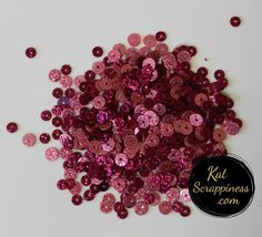 Kat Scrappiness Brand Sequin Mixes: Raspberry Sparkles Each package contains approx. 3+ teaspoons/1 tablespoon of sequins which comes in a clear re-sealable plastic bag.