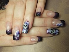 Black and purple gel polish with one stroke flower nail art and freehand skull