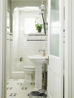 Even a small bathroom can make a large impact . Start with clever storage - stash your toiletries inside a wall - hung bathroom cabinet wit...