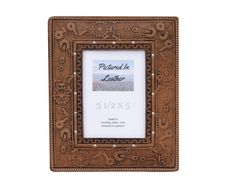 $38 How about a high quality leather picture frame with an embossed steampunk design? This 3-1/2x5 frame is just what you are needing for that special picture! It's a light brown frame with a Plexiglas and an easel back. Great for your steampunk decor, steampunk gift or let it be a great addition to your other decor!