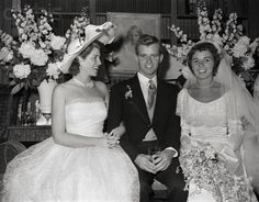Robert Francis Kennedy and his bride, the former Ethel Skakel, and the groom's sister, Eunice Kennedy, who was a bridesmaid at the wedding, are enjoying a joke at the sumptuous reception at the Skakel estate in Greenwich, Connecticut - June 17,1950