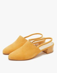"""Timeless slingbacks from Anne Thomas in Virginia. Suede upper. Pointed toe. Subtle elasticized goring at strap. Low wood heel. • Leather upper • Leather sole • 1.5"""" heel • Made in Portugal"""
