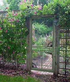 use an old screen door for your garden gate-great way to incorporate deer fencing and make it more interesting/beautiful