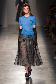 Swiss dots, embroidered florals and lace added texture in places, but it was the simple combination of a knit t-shirt worn with a layered tulle and Swiss dot skirt that felt like the coolest spin on evening.