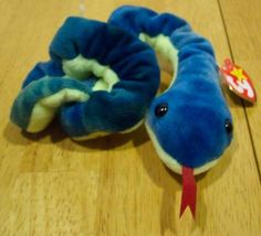 "$15 (4) TY Beanie Baby HISSY THE SNAKE 5"" Plush STUFFED ANIMAL Toy This is a Beanie Baby HISSY THE SNAKE Plush Stuffed Animal. Made by TY in 1997. It is 2 1/2 inches tall and 5 inches wide, when curled up. It is NEW with the tag."