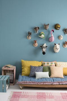 colourfull kids room | playroom with bright colours, pillows and funny animal heads against the wall