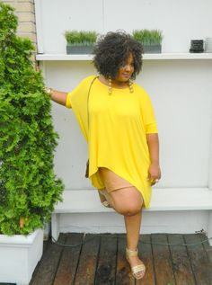 The Curvy Fashionista Marie Denee at FFFWeek- looooooove the pairing of the bright floaty top with the nude leather  skirt. Werk!