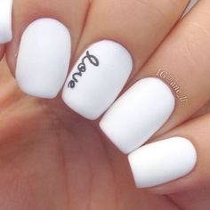With a steady hand and a small brush, add dainty script to opaque white nails for a look that's both girly and modern. #NailArt #NailDesigns