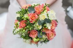 My wedding bouquet. Miss piggy roses and Freesias