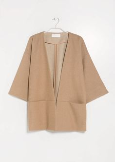 kimono something like this, just with longer arms, during winter over maxi dresses and stuff...