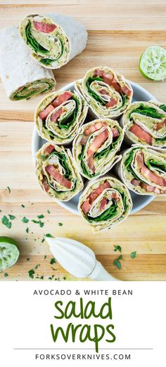Avocado and White Bean Salad Wraps. Made with baby spinach northern beans tomatoes lime juice parsley tamari (or soy sauce) spices and wheat tortillas. Healthy lunch or dinner.