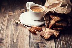 Coffee and cookie - Cup of coffee and cookies on wooden background