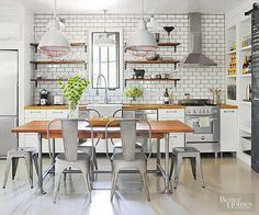Quintessential farmhouse kitchens include a long table at the center of the room for gathering and dining. This wood-top table offers a contemporary vibe with its tubular metal base and metal chairs and stools. Scoot the seating out of the way, and your table offers another work surface with an ideal height for rolling out dough.
