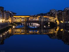 """Like the floating clouds and flowing streams: Ponte Vecchio: Firenze, Italy  """"The Arno is flowing quietly like the eternal flow of time through this old city, where many great figures lived their stormy lives and left prominent achievements behind.  Just before the thick darkness descends, the lapis lazuli blue of twilight is finely reflected in the calm water of this river."""""""