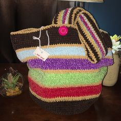 🎗Hand knitted bag Proceeds of this piece go towards cancer research. It's so soft and well made, perfect for anything you can carry a lot, it's very stretchy.(not FP- for exposure) hand made Bags