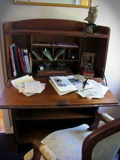 A nostalgic, focused, vintage writing desk piled up with the tools of the trade. Vintage Writing Desk, Writing Bureau, Cabana, Writers Desk, British Colonial Style, Desk Space, Elegant Homes, Home Office, Sweet Home