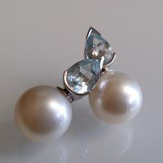 Pendientes de perlas de los mares del Sur (australianas) y Aguamarinas. Perlas de 13.7 mm de diámetro (certificadas por el GIA); aguamarinas de 2.32cts. Montados en oro blanco de 18K.