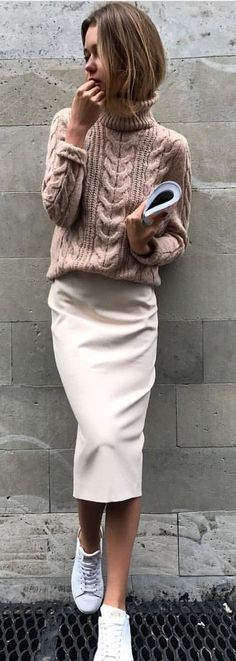#spring #outfits woman wearing peach turtleneck sweater and white midi skirt. Pic by @speak__fashion