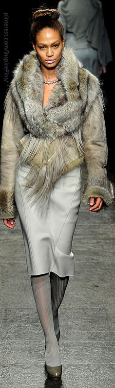 Donna Karan. BOYCOTT any designer using fur from any animal.  Synthetic only.
