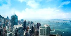 The view from the Hong Kong Monetary Authority on the 55th floor of Two #IFC. The vista takes in the western entrance to #VictoriaHarbour, with Stonecutters Bridge and Kowloon in the distance. #Photography #VantagePoints #Perspective #DiscoverHongKong #HongKong #Scenery #View #Travel