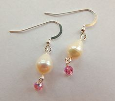 Check out this item in my Etsy shop https://www.etsy.com/listing/230487008/pink-swarovski-earringspearl