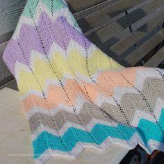 """A sweet little swaddling blanket knit in sport weight yarns. 22x26"""""""