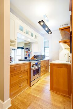 Custom Woodwork in a Sweetened Manhattan Kitchen