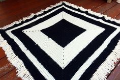 This is a soft acyrlic, mixed fibre blanket. Perfect for babies this Autumn and Winter as it is a breathable pattern to prevent over-heating whilst staying cosy Mixed Fiber, Crochet Granny, Blanket, Rugs, Pattern, Collection, Farmhouse Rugs, Crochet Pattern, Patterns