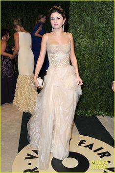 Selena Gomez wore an Atelier Versace dress, Jimmy Choo heels, Lorraine Schwartz jewels, and a Judith Leiber clutch.