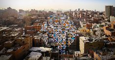 eL Seed fuses Arabic calligraphy with graffiti to paint colorful, swirling messages of hope and peace on buildings from Tunisia to Paris. The artist and TED Fellow shares the story of his most ambitious project yet: a mural painted across 50 buildings in Manshiyat Naser, a district of Cairo, Egypt, that can only be fully seen from a nearby mountain.
