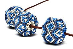 Cover plain wooden beads with beautiful patterns in right-angle weave and peyote stitch