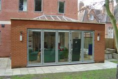 Brick Built Extension with Glass Roof and 5 Door Bi-folding doors Brick Extension, House Extension Plans, House Extension Design, Building Extension, Extension Ideas, 1960s House, Roof Lantern, House Extensions, Kitchen Extensions