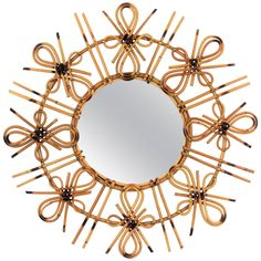 Unusual Spanish 1950s Rattan Sunburst Mirror with Chinoiserie or Tiki Accents