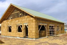 A partially constructed straw bale house