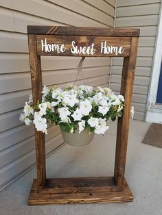 Hanging Flower Basket Stand Comes in several different colors Stains: Dark Walnut, Ebony, Provincial, and Carbon Gray Solid: White, Gray, Black Writings: Choose your Colors Standard has been white or black, but can do any Choose your saying standards have been Welcome or Last Name,