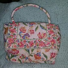 """Vera Bradley small bag purse. Perennial pattern cream colored with beautiful flowers.  This is a small bag that measures approximately 7 1/2"""" across the base,  3"""" deep, 7"""" tall and with a 3"""" strap drop. It would be perfect for your little girl or to take out at night with that cute dress.  There are no rips, tears, fraying or holes in this bag.   If you have any questions please don't hesitate to ask.    VB1 Vera Bradley Bags"""