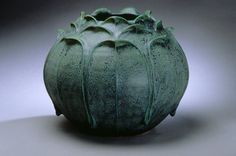Medium: Clay, this pot appeals to me because the petal designs are intricate, and seem hard to make