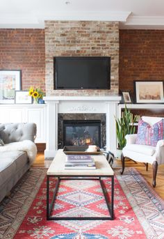 The couple chose the area rug together, which features an abundance of colors and is the statement piece in the space.  - GoodHousekeeping.com