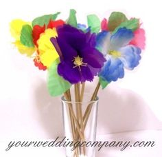 Hibiscus picks make fun accents for island luaus, dessert buffets and beach wedding receptions. www.yourweddingcompany.com