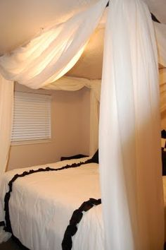 This seems an even better canopy bed, and all it would leave is a couple screw holes in the ceiling.