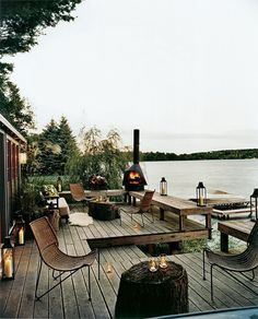 Fireplace and lighting give the lakeside deck a surreal appeal [Design: Thom Filicia Inc.]