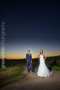 Bride and groom pose for a portrait under the stars