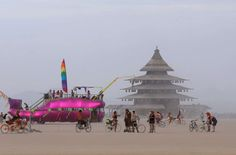 An art car and the Temple Project are visible on the Playa on Aug. 29.