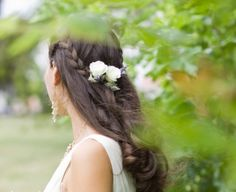 Half Up Bohemian Hairstyle with braids and accented with roses and lavender