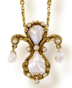 An antique freshwater pearl, diamond and fourteen karat gold pendant necklace, Marcus & Co., circa 1905  the pendant with beaded scroll motifs set with four freshwater pearls, measuring approximately 13.60 x 11.60 to 7.60 x 6.55mm., and accentuated by ten old mine-cut diamonds, reverse with chased and engraved designs, suspended from a chain of foliate links with two old mine-cut diamonds and beaded accents; pendant convertible to a brooch;  attributed to Marcus & Co